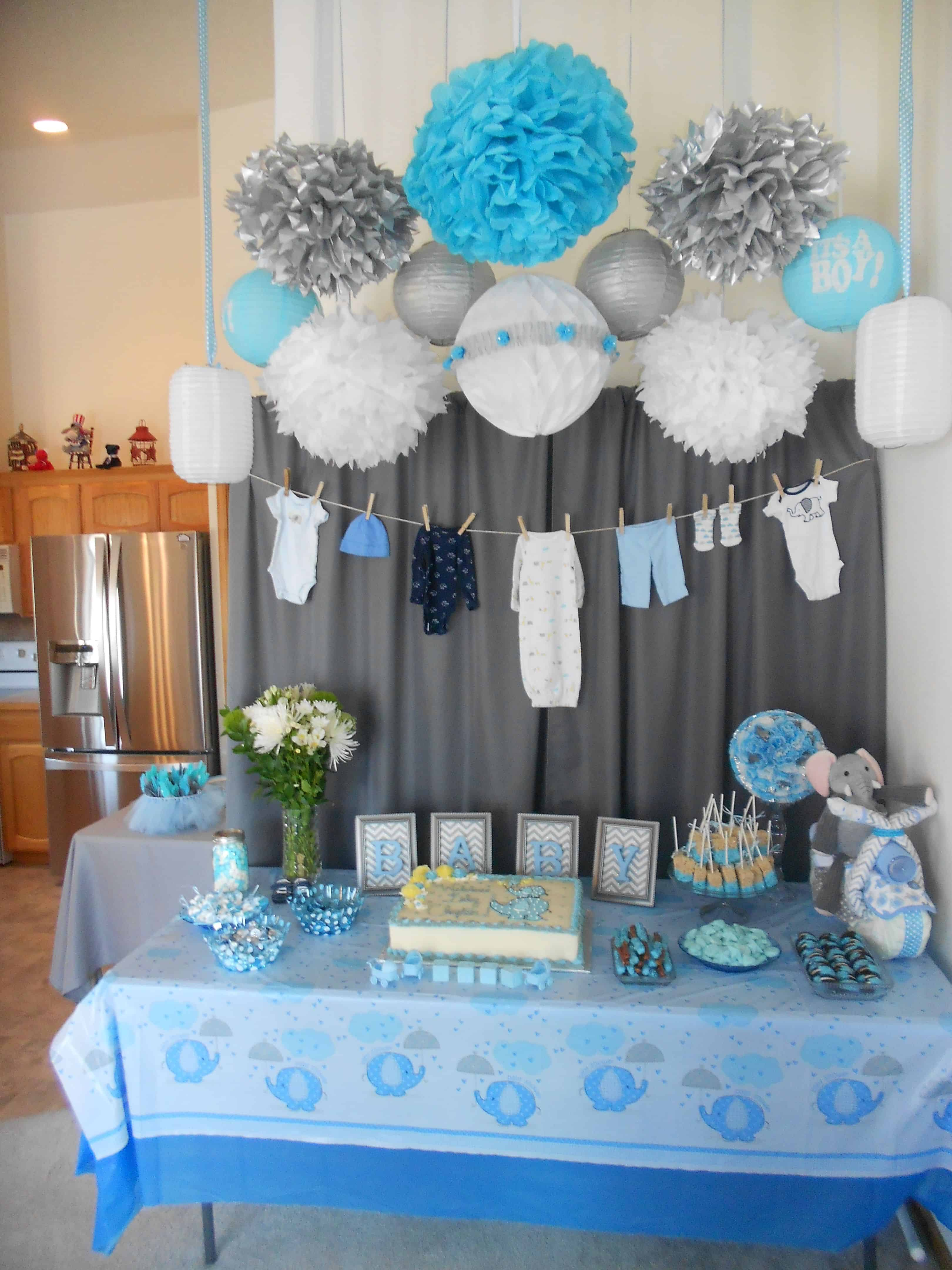 table and backdrop decorated blue and grey so a baby boy shower