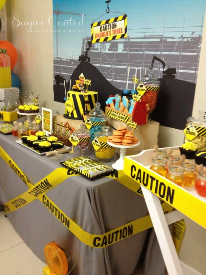 construction zone themed baby shower table, food and decor in yellow, black and orange colors