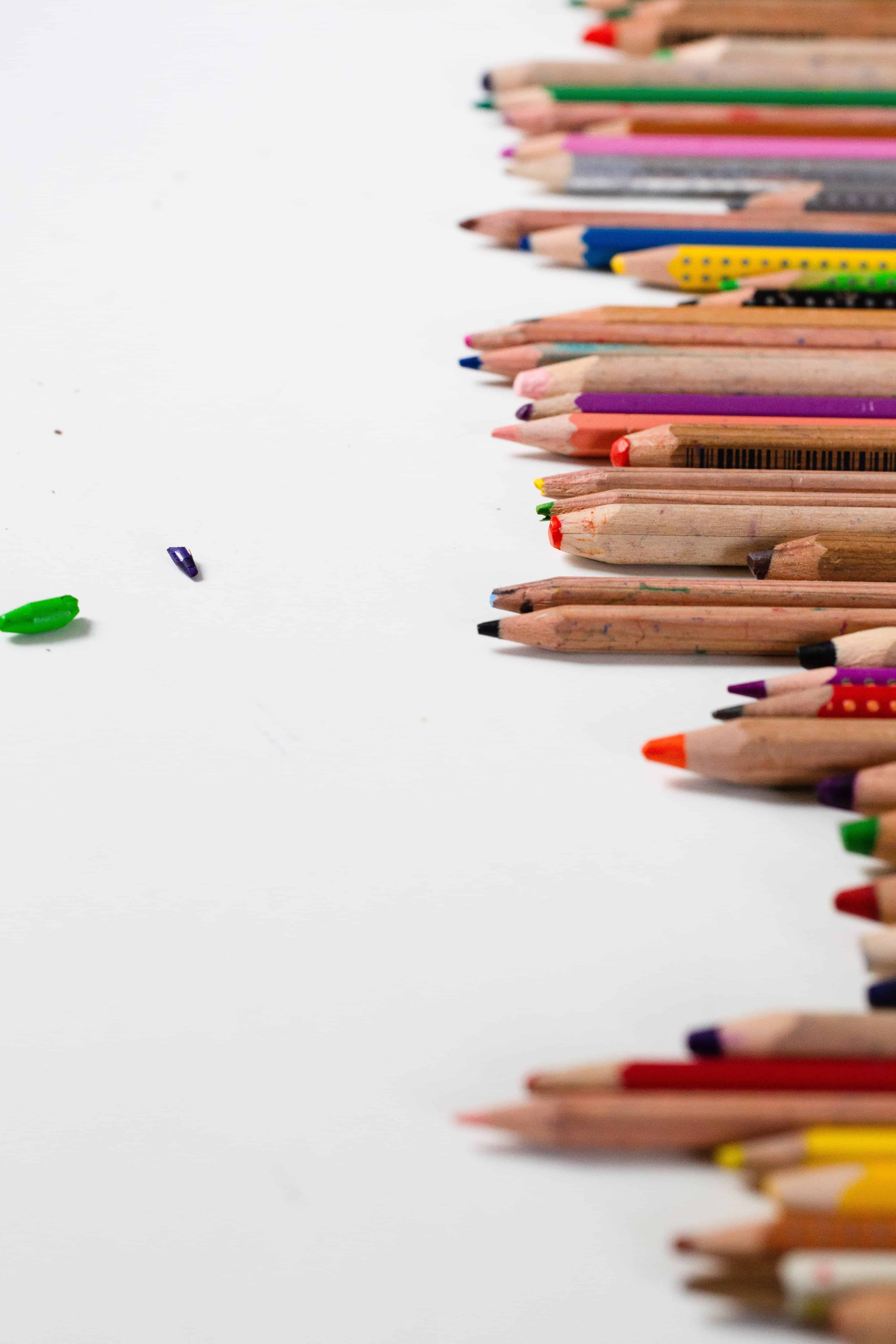 sharpened pencils on a white table