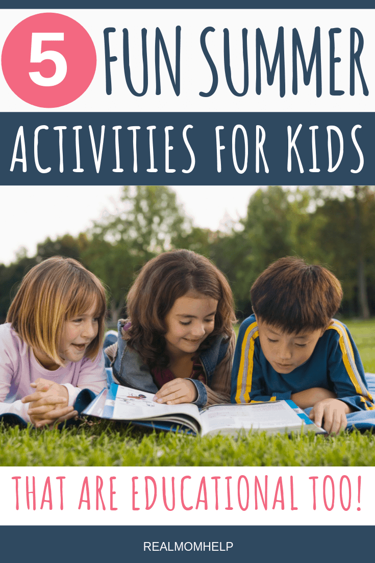 three kids reading books on the lawn