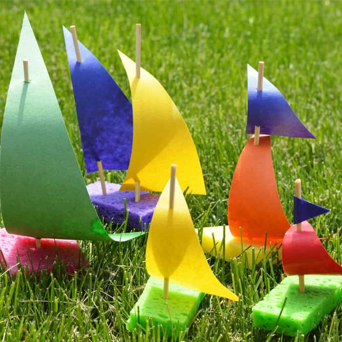 colorful sailboats made out of wooden skewers, paper and sponges as a summer craft