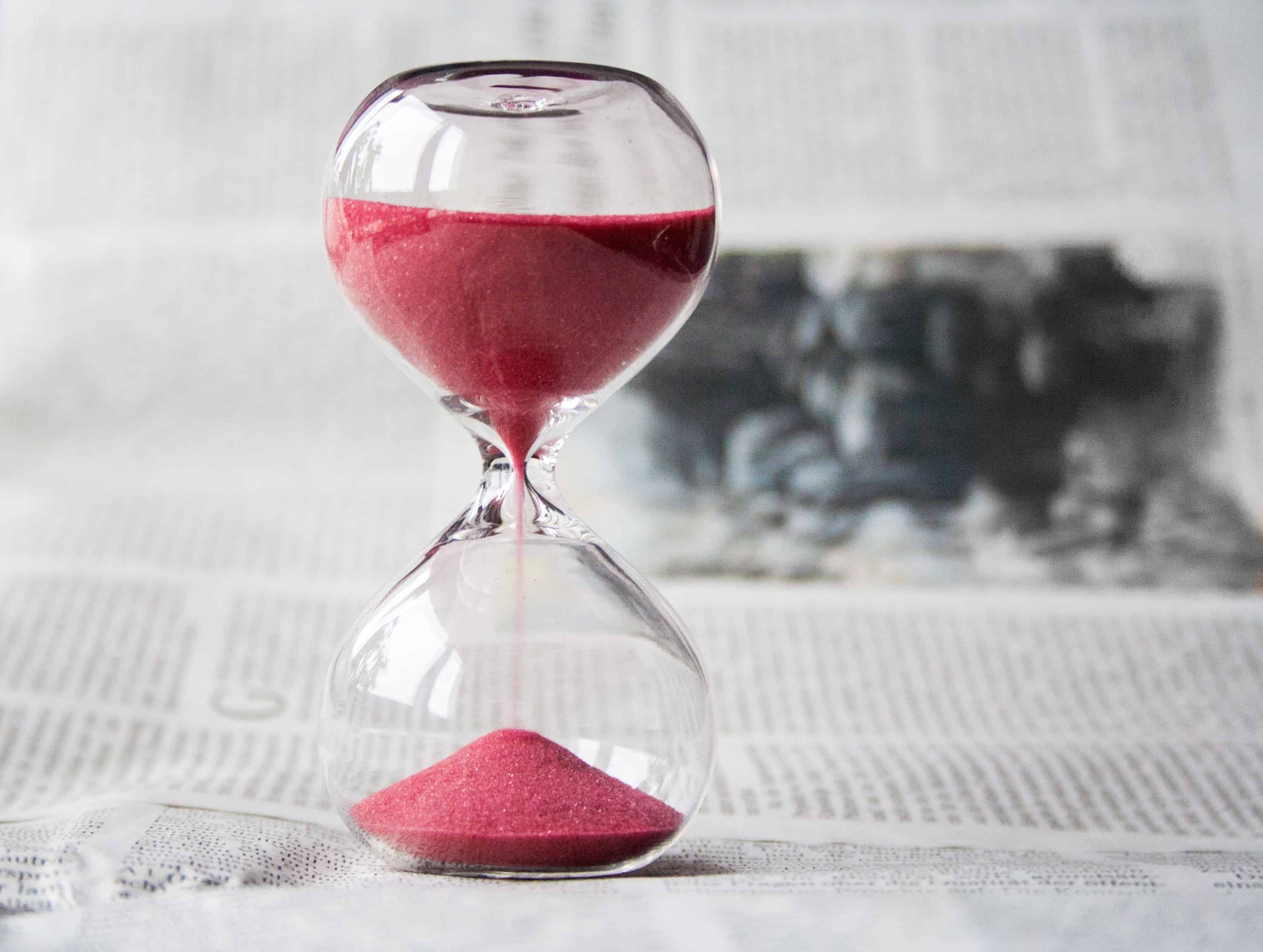 hourglass with red sand